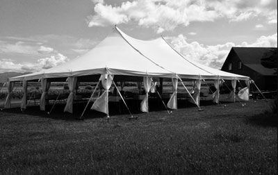 Rental tent for special events set up in field next to barn
