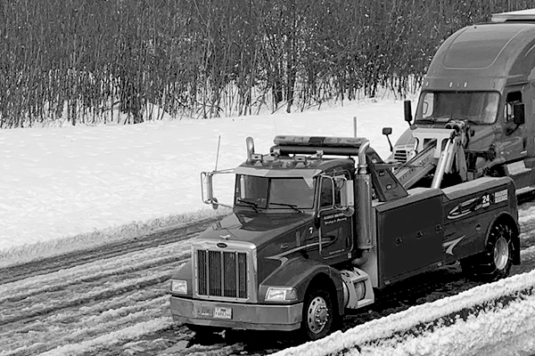 Tow truck driving in snow